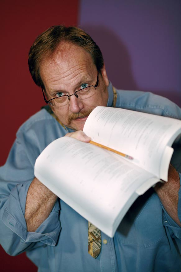 image of Dr. Hershey holding a literature book