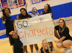 Cheerleaders with sign: Go Chargers