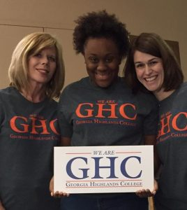 Employees holding We are GHC sign