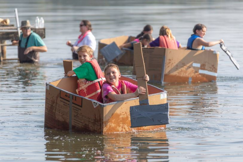 students in cardboard boat challenge