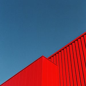 red building against blue sky