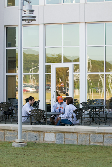 students eating outside at student center