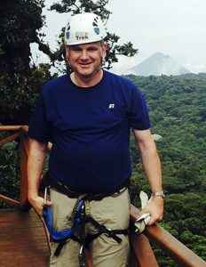 Mark Greger wearing protective gear to go zip lining