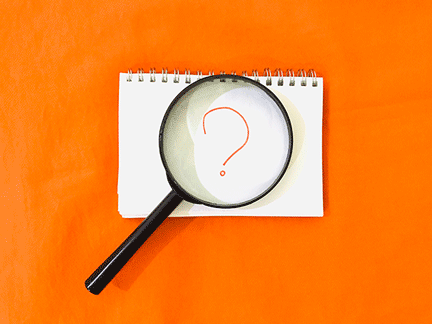 magnifying glass over question mark