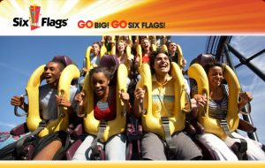 People enjoying a roller coaster at Six Flags