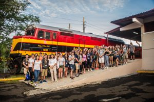 students in front of cargo train